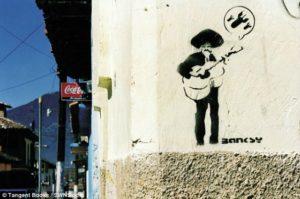 stencil de banksy en chiapas mexico